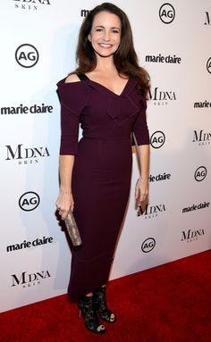 KRISTIN DAVIS in a burgundy dress, black lace peep-toe booties and a metallic clutch | See the best red carpet looks from this week