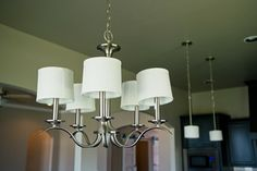 Classic brushed nickel chandelier with mini drum shades Brushed Nickel Chandelier, Beacon Lighting, Unique Lighting, Drum Shade, Light Fixtures, Shades, Ceiling Lights, Mini, Classic
