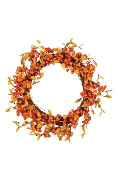 This decorative wreath lends a burst of autumnal color to the front door or porch wall.