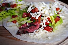 Cilantro Lime Flank Steak Tacos - Steak marinated in a cilantro lime marinade and grilled to perfection, stuffed into tacos and topped with all the fixings! Skirt Steak Tacos, Flank Steak Tacos, Marinated Flank Steak, Grilling Recipes, Beef Recipes, Healthy Recipes, Healthy Dishes, Clean Recipes
