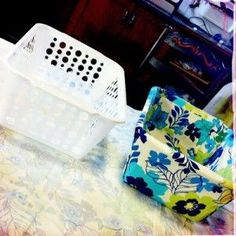 Dollar Store Bins covered with fabric using hot glue (no sewing needed). Love this idea!