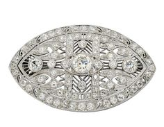 A Diamond and Platinum Brooch, circa 1920. The navette-shaped pierced plaque of geometric and foliate design decorated throughout with round and old European-cut diamonds, mounted in platinum.