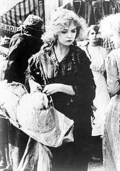 kitty-packard:  Lillian Gish in a scene from the 1912 D.W. Griffith film 'Musketeers of Pig Alley.'