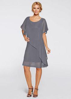 Ponadczasowa elegancja! Sukienka sprawiająca wrażenie dwuczęściowej, z asymetryczną wierzchnią warstwą. Z lekkiej tkaniny. Szerokie rękawy. Dł. w rozm. 38 ok. 98 cm.