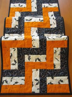 Halloween Quilted Table Runner with Bats and Stars by patchworkmountain.com