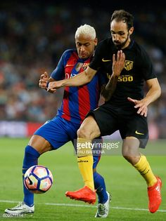 Barcelona's Brazilian forward Neymar vies with Atletico Madrid's defender…