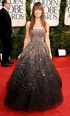 This is my favorite red carpet look of all time; it's actually my favorite dress of all time.  I would have nowhere to wear it at this time, though I hope one day I will.  I can't imagine a more beautiful dress than this Marchesa stunner Olivia Wilde wore to the 2011 Golden Globes.  This is the dress my dreams are made of!