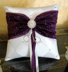 Wedding Ring Bearer Pillow White Mystic Purple or Custom Made to your Colors with Swarovski Crystal Flower. $50.00, via Etsy.
