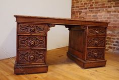 SOLD SOLD SOLD SOLD SOLD Oak Pedestal Desk With Lion Head Carved Handles available from Lillyfee Woodcarving Studio. Wonderful solid Oak pedestal desk with hand carved details and leather top.   There are 3 generously proportioned deep drawers on each side of the desk with hand carved lion face handles and decorative filigree. The desk has many little charming details which includes scroll carved brackets. Office, desk, study, furniture, lion, english, oak, interior, design,