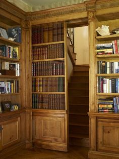 Sliding bookcase door to staircase entry.