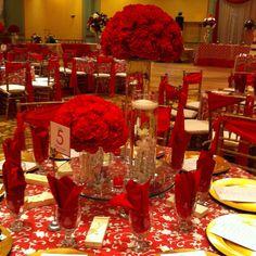 Red wedding decor  Www.flowersbyamore.com