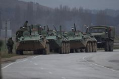 Russian armored personnel carriers and a truck are parked on the side of the road near the town of Bakhchisarai, Ukraine, Friday, Feb. 28, 2014.