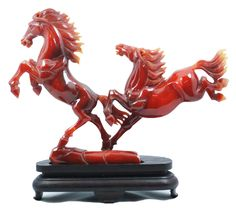 Hand carved Chinese dark red jade group figure of wild horses. Each horse is finely carved with high detail. Breathtaking translucence to this deep red jade. 19th century.