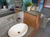 Learn how to pour a concrete floor for a masculine feel to a bathroom.