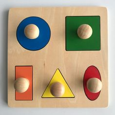 The Geometric Puzzle Board is specifically designed for toddlers. The 5 basic geometric shapes are represented in primary and tertiary colours Puzzle Board, Puzzle Pieces, Islamic Art Pattern, Pattern Art, Montessori Infant, Tertiary Color, Kids House, Geometric Shapes, 18 Months