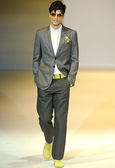 Yellow hint of color with dark suit.