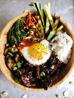 These Korean Bibimbap Bowls are so fresh and full of flavors! The Korean flavors, fresh veggies, well seasoned meat, and rice mix so well with the fried egg Spicy Recipes, Asian Recipes, Beef Recipes, Cooking Recipes, Healthy Recipes, Ethnic Recipes, Healthy Eats, Vegetarian Recipes, Recipies