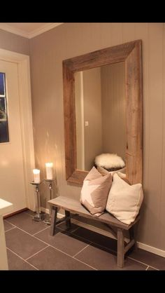 Large mirror in hallway entrance to create more light along with seating
