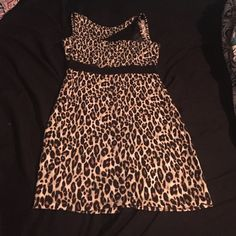 Sexy, leopard, mini dress with black mesh cutouts This dress can be worn out for a night on the town or for date night! It has only been worn twice since I purchased it. No zippers or buttons to struggle with! Charlotte Russe Dresses Mini