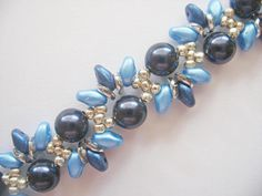 This tutorial includes details, easy step by step instructions with colour photos/pictures and materials list. It is part of my wavy bracelet series. The bracelet is made using Swarovski pearl, o-beads, superduo beads and seed beads, which are easily available. Time required approximately