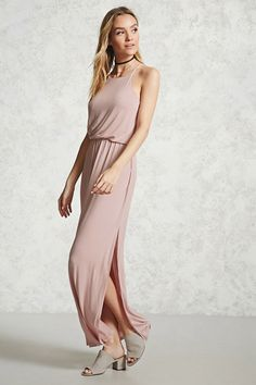 Style Deals - A jersey knit maxi dress featuring cami straps, a scoop neck, a draped bodice with elasticized waist, and a back slit detail.