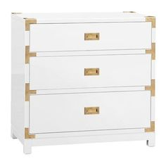 Tansu Glossy White Lacquer 3 Drawer Chest. The Tansu Chest boldly updates the classic campaign style. The three drawer chest or side table is adorned with gold accents and recessed pulls.