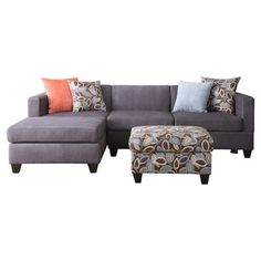 Sectional sofa with charcoal upholstery and a floral ottoman.Product: Sectional sofa and ottomanConstruction Material: