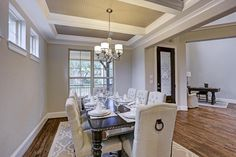 4907 Dumfries Dr. Elegant formal dining room features gleaming hardwood floors, tray ceiling with beautiful bead board accents and large windows that overlook the beautiful front porch. Bernstein Realty, Houston Real Estate.
