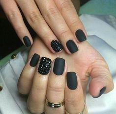 Matte black nails with studs