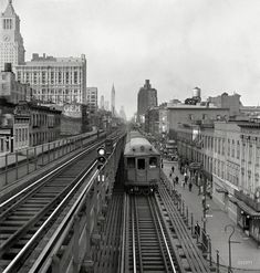 "September 1942. ""New York. Looking north from the Ninth Street station on the Third Avenue elevated railway as a train leaves on the local track."" Medium format negative by Marjory Collins, Office of War Information."
