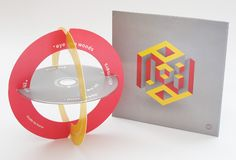 Plaid's new album Scintilli, released on Warp. The album is packaged in an oversized CD digipack, due to the inclusion of two printed rings with which, together with the CD itself, you can make the pictured sculptural piece. Cd Packaging, Innovative Packaging, Packaging Design, Cd Design, Album Cover Design, Creative Design, Pochette Dvd, Cd Artwork, Creative Review