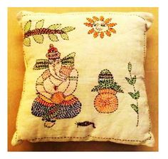 Beautify your Home with this kantha embroidery stitch small scented cushion, it gives new and exceptional look to your decor. This cushion is decorated with Ganeshji and the Sun shining overhead. Perfect gift that add lively colors to your decor. The base color is whiteHandmade, Indian Luxury embroidered furnishings for Living Room, Dining Room, Bedrooms, Plagrooms and Study rooms or formal table linen in silk, cotton, jute, velvet or organdy  for Corporate Dining, all is now available at…