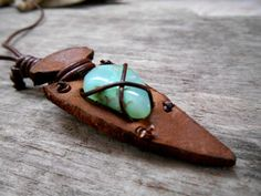 A pretty necklace for a surfer men or a pretty boho woman !    The necklace is composed of leather cordon, a leather Arrow overhang by a Chrysoprase stone. The necklace is 32 cm(12.5 inches) long.    Simple and unisex, try this necklace, you or your love