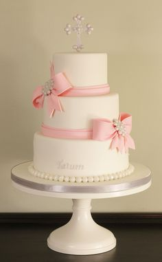 https://flic.kr/p/hLUXWC | Fondant Bows Baptism Cake | Three tier baptism cake with fondant bows, pearls, topper and brooches.