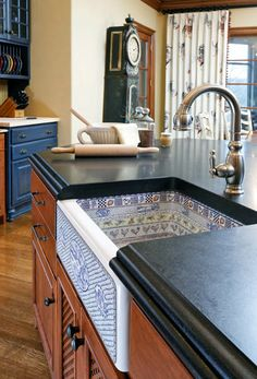 Blue Accents In Cabinets Or Accessories Liven Up A Kitchen Space.