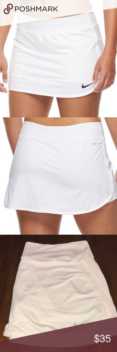 Nike white tennis skort PRODUCT FEATURES Perfect for medium-impact exercise Dri-FIT moisture-wicking fabric Built-in shorts with ball pocket Dolphin hem FIT & SIZING Elastic waistband FABRIC & CARE Polyester, spandex.  Preloved white tennis skort.  Great condition no flaws. Nike Shorts Skorts