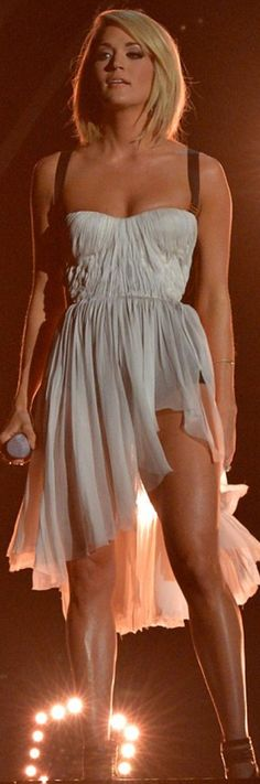 Who made  Carrie Underwood's white ruched dress?