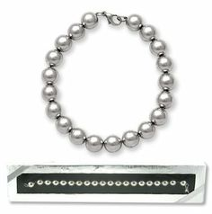 Silver Bead Bracelet Strung On Chain - Designer Inspired! My Jewel Thief. $13.80. Wonderful staple to you jewelry wardrobe!. Sterling Silver Plated.. Wonderful Gift!. Ready for gift giving - all gift boxed and ready to go.. Gorgeous Silver Beads strung on a rounded cable chain