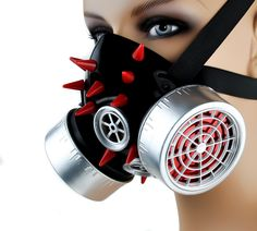 Red Spike Dual Respirator Gas Mask This is a very well though out Design, made with the highest quality and care. Silver Canaster Discs w/ Red Plastic Spikes. This Mask is very lightweight and easy to