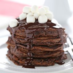 Hot Chocolate Pancakes feature rich chocolate buttermilk pancakes with a thick chocolate fudge topping and garnished with mini marshmallows.