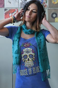 Click To Get Your Gear | Celebrate the art and history of Dia de Los Muertos with this festive sugar skull from House of Blues. A cotton blend makes this a soft, comfy feel too!  50% Polyester, 25% Cotton, 25% Rayon