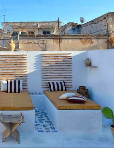 Fixed day beds in this Moroccan beach side house in Essaouira. Blocky and stable.