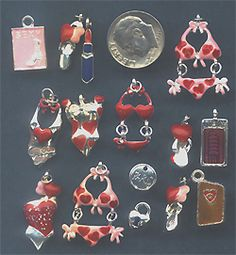 Unique charms, embellishments, filigree stampings, rhinestone dangles from NotJustPartz. Themes include Dreses, Fashion, hats, Shoes, Pumps, Bathing Suits, Red hat, Boots.
