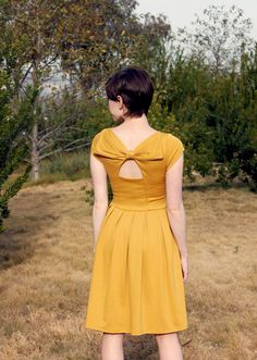 Holly golightly in mustard muted yellow dress with pockets