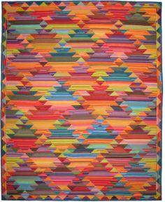 Haze Kilim quilt made by Lori Allison at Design Tyme. Pattern by Kaffe Fassett