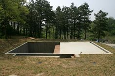 Earth House by Byoung Soo Cho  The 14mx17m underground concrete box contains 6 rooms and 2 courtyards.