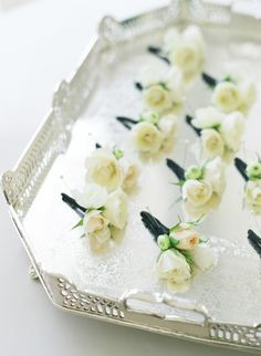 The corsages will be ivory spray roses and green bupleurum wrapped in a band of ivory ribbon with the stems showing