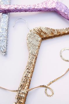 Learn how to make a set of sequin hangers for your clothes with this home organization DIY project.