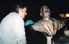 """Chris working on a faux bronze bust for the film """"The Day After Tomorrow"""" 2003 Plaster, metalic paints and patina"""