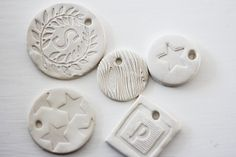 Sculpey + a stamp.  Works for ornaments or gift tags.  Aubrey & Lindsay's Little House Blog